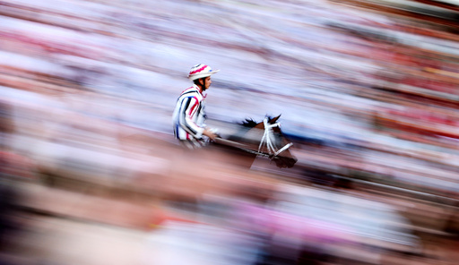 Jockey Elias Mannucci of Istrice (Porcupine) parish rides his horse during the first practice for the Palio horse race in Siena