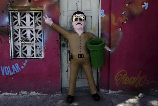 A pinata depicting drug lord Joaquin