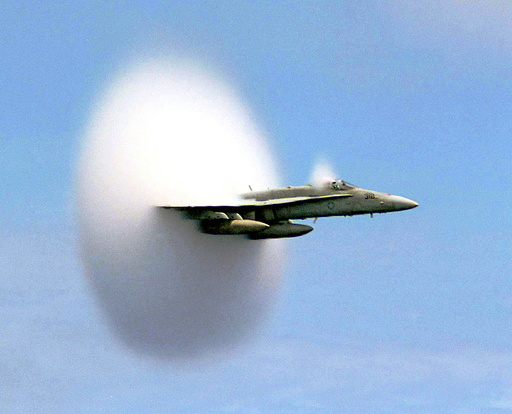 Handout file photo shows Lieutenant Ron Candiloro, assigned to Fighter Squadron One Five One, breaking the sound barrier in an F/A-18 Hornet fighter plane