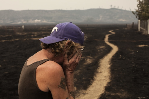 Robert Hooper, exhausted after several days with little sleep, is overcome with emotion while surveying his property that was burnt by the so-called Valley Fire near Middleton, California