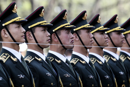 Members of a Chinese People's Liberation Army (PLA) honour guard stand behind a string to ensure that they are in a straight line before a welcoming ceremony for Swiss President Johann Schneider-Ammann at the Great Hall of the People in Beijing