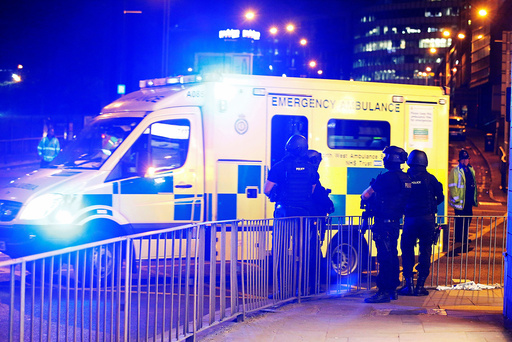 Armed police officers stand near the Manchester Arena, where U.S. singer Ariana Grande had been performing, in Manchester, in northern England, Britain
