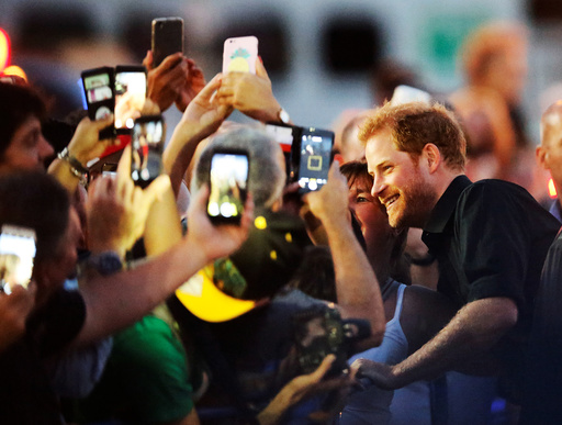 Britain's Prince Harry greets the public as he arrives for the Invictus Games Foundation reception at the CN Tower in Toronto
