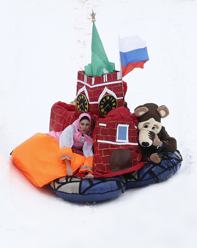 Participants compete during a contest on the longest distance and the most creative performance at the 'Battle sani' festival of self-made sledges in Moscow