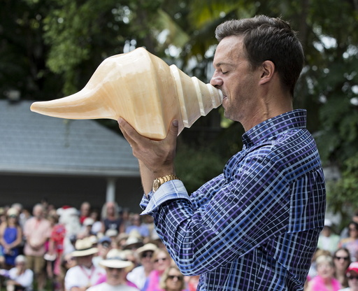 Handout of Fritz blowing a huge shell during the Annual Conch Shell Blowing Contest in Key West