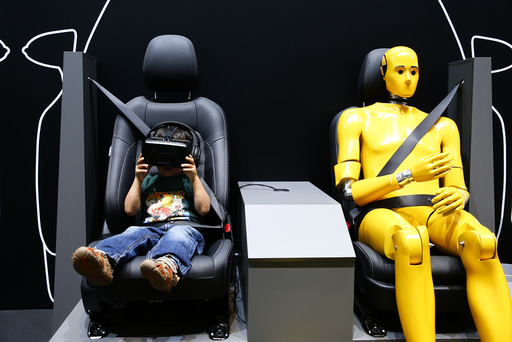 A young boy watches a virtual drive at the Toyota booth at the Frankfurt Motor Show (IAA) in Frankfurt