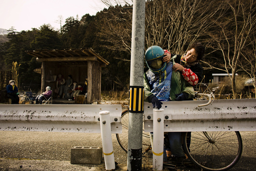 Local villager Ayano arranges scarecrow in village of Nagoro