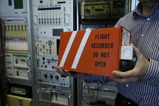 An employee of Germany's Bundesamt fuer Fluguntersuchung BFU holds a cockpit voice recorder, an up-to-date model by L-3 Aviation Products that is used in Boeing and Airbus aircraft, at their headquarters in Braunschweig