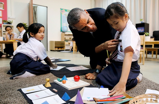 U.S. President Barack Obama learns a girl's name as he greets students on a tour of the Dignity for Children Foundation, in Kuala Lumpur, Malaysia