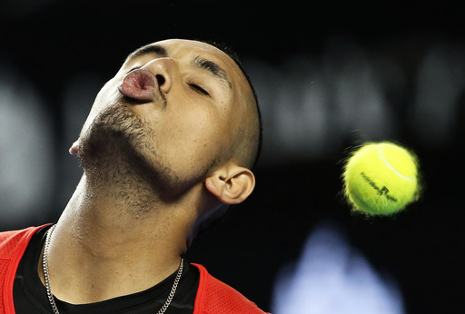 Australia's Kyrgios tries to kiss the ball as it flies past during his second round match against Uruguay's Cuevas at the Australian Open tennis tournament at Melbourne Park