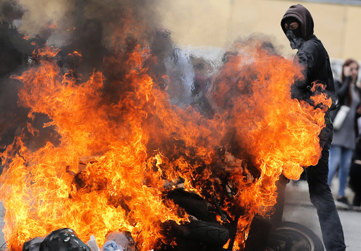 Protestors surround a burning scooter during a demonstration against French labour law reform in Nantes