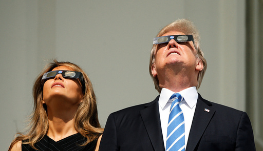 Trump watches the solar eclipse from the White House in Washington