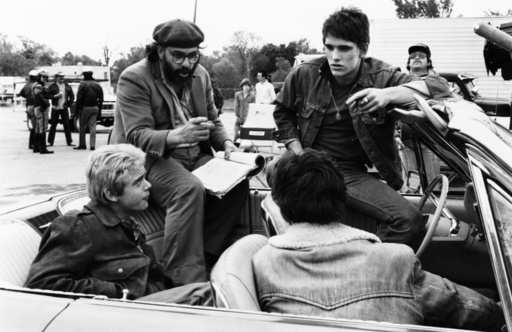 THE OUTSIDERS, front: C. Thomas Howell; back: director Francis Ford Coppola, Matt Dillon, on set, 19