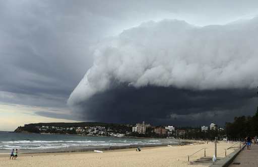 A wave-like cloud looms over Sydney's Manly Beach during an afternoon storm front