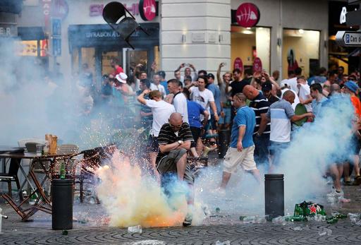 A teargas grenade explodes near an England fan ahead of England's EURO 2016 match in Marseille