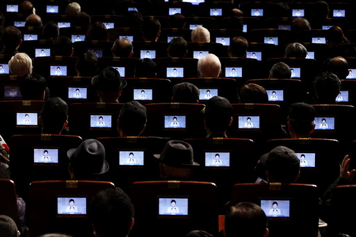 South Korean President Park Geun-hye is seen on small screens fitted in seats as she delivers a speech during a ceremony celebrating the 97th anniversary of the Independence Movement Day in Seoul