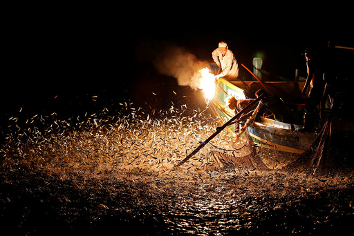 The Wider Image: Fishing with fire