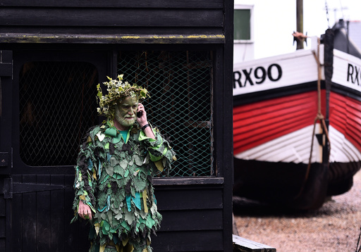 A participant takes part in the annual Jack In The Green parade in Hastings