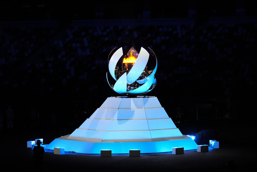 The Olympic flame is extinguished during the closing ceremony in the Olympic Stadium at the 2020 Summer Olympics, Sunday, Aug. 8, 2021, in Tokyo, Japan. (AP Photo/Aaron Favila)