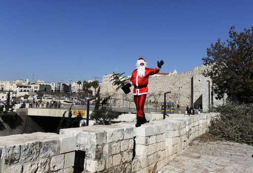 Israeli-Arab Issa Kassissieh poses for the media wearing a Santa Claus costume in Jerusalem's Old City