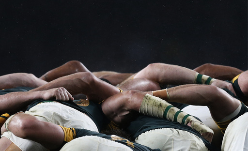 South Africa players compete in a scrum with New Zealand players during their Rugby World Cup Semi-Final match at Twickenham in London