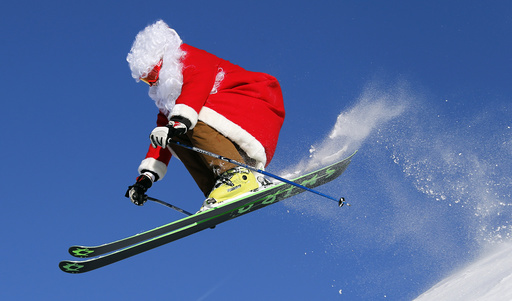 A freerider dressed in Santa Claus costume, ski teacher Ronchi jumps in Madonna di Campiglio