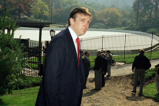 FILE - In this Oct. 23, 1986, file photo, Donald Trump is photographed in New York's Central Park, in front of the Wollman Skating Rink, which he offered to rebuild after the city's renovation effort had come to a standstill. New York City is looking to terminate its contracts with Trump to run two Central Park skating rinks and other facilities after a Trump-inspired mob rioted and breached the U.S. Capitol, Mayor Bill de Blasio said Tuesday, Jan. 12, 2021. (AP Photo/Mario Suriani, File)
