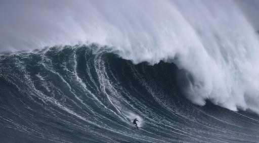 Big wave surfer Sebastian Steudtner of Germany drops in on a large wave at Praia do Norte in Nazare