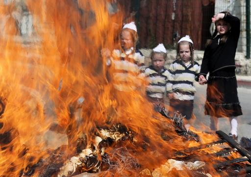Ultra-Orthodox Jewish boys burn leaven in the Mea Shearim neighbourhood of Jerusalem ahead of the Jewish holiday of Passover