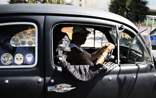 A resident drives his Volkswagen Fusca during the Fusca National Day near Ipanema beach in Rio de Janeiro