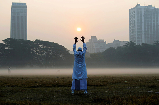 A man exercises in a park on a winter morning in Kolkata