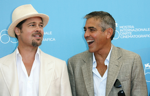 U.S. actors Clooney and Pitt pose during photocall in Venice