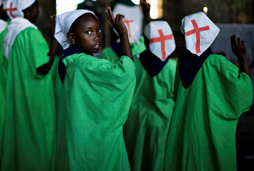 Congolese girl prays during Sunday mass in village of Mweso