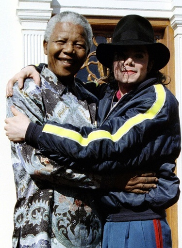 File photo of South African President Nelson Mandela and pop star Michael Jackson hugging each other at the president's official home in Capetown