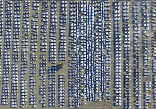 An aerial view shows new Audi cars in an open-air parking lot in Changchun