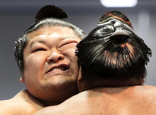 Sumo wrestlers compete during the annual 'Honozumo' ceremonial sumo tournament dedicated to the Yasukuni Shrine in Tokyo, Japan