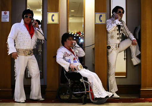 Amateur contestants pose in telephone booths during the annual European Elvis Tribute Artist Contest and Convention in Birmingham