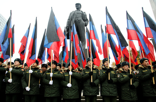 Students of a military school stand in formation in front of a monument to Soviet state founder Vladimir Lenin before the march marking the Day of Flag of the self-proclaimed Donetsk People's Republic in the rebel-controlled city of Donetsk