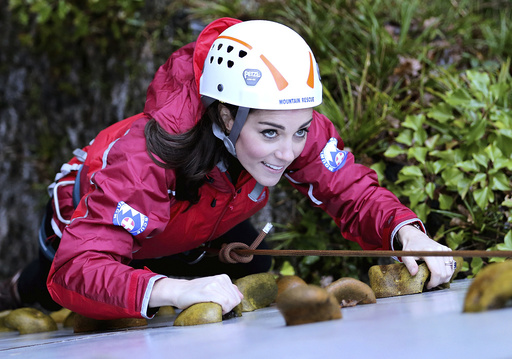 Britain's Catherine, Duchess of Cambridge, ascends a climbing wall as she visits the Towers Residential Outdoor Education Centre in Capel Curig