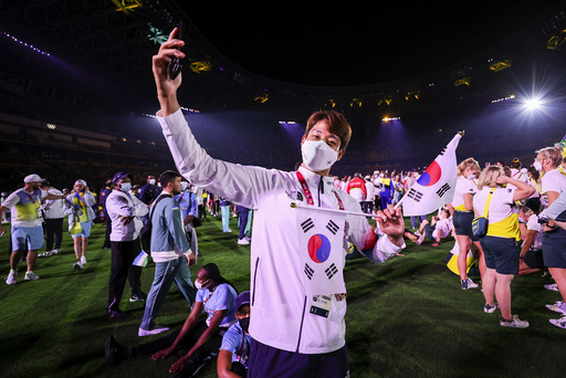 An athlete of South Korea poses during the closing ceremony in the Olympic Stadium at the 2020 Summer Olympics, Sunday, Aug. 8, 2021, in Tokyo, Japan. (Dan Mullen/Pool Photo via AP))