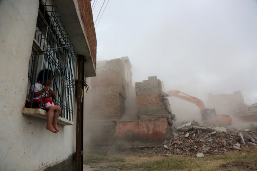 An excavator wrecks a building as part of an urban transformation project in Sur neighborhood in the Kurdish-dominated southeastern city of Diyarbakir