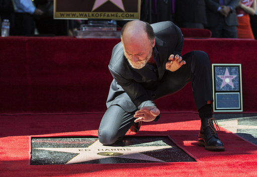 Actor Harris poses on his star after it was unveiled on the Hollywood Walk of Fame in Los Angeles