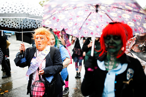 People participate in the World Zombie Day in London