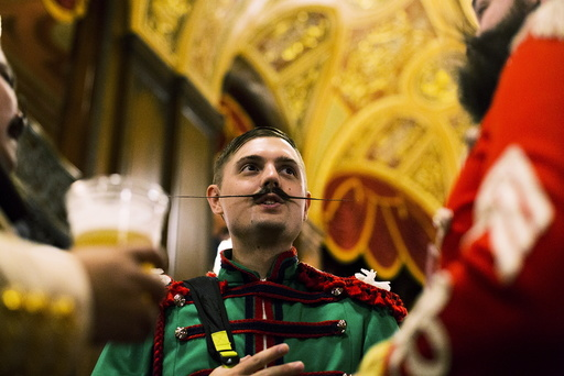 Contestants chat during intermission at the 2015 Just For Men National Beard & Moustache Championships at the Kings Theater in the Brooklyn borough of New York