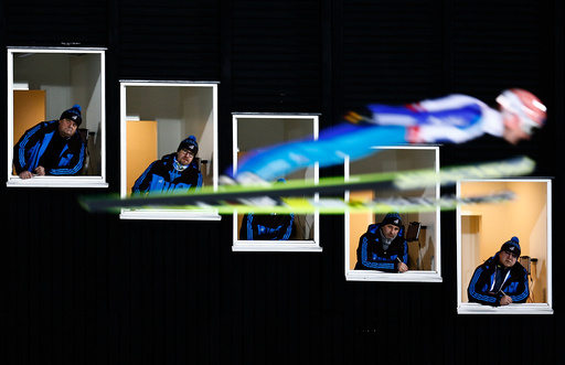 Freund of Germany soars past judges windows during the normal hill HS100 mixed team ski jumping event of the Nordic World Ski Championships in Falun