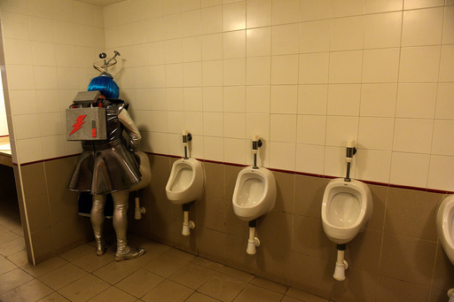 A reveller is seen in the bathroom during carnival celebrations in Gijon