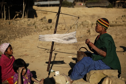 A Naga woman weaves using a traditional method in Yansi village, Donhe township in the Naga Self-Administered Zone