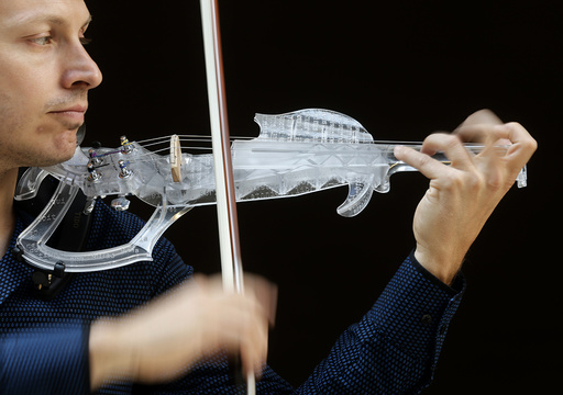 French engineer and professional violinist Laurent Bernadac plays a 3D printed violin in Paris