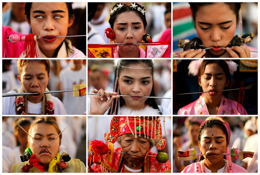 Devotees of the Chinese Jui Tui shrine are seen with spikes piercing their cheeks during a procession celebrating the annual vegetarian festival in Phuket