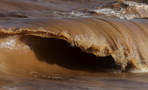 A wave is pictured on the sea near the mouth of Rio Doce, which was flooded with mud after a dam owned by Vale SA and BHP Billiton Ltd burst, as the river joins the sea on the coast of Espirito Santo in Regencia Village, Brazil